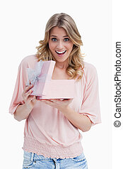 Young woman showing her surprise with a present
