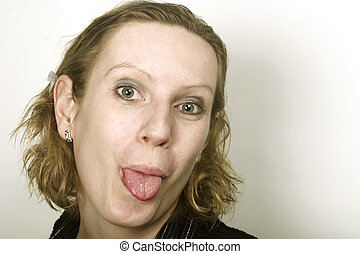 Young woman showing her tongue. Lot of workspace on right side.