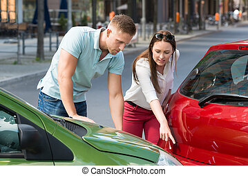 Young Woman Showing Man Car Collision At Roadside