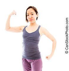 Young woman showing off her muscle