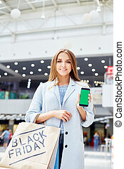 Young Woman Showing Shopping App