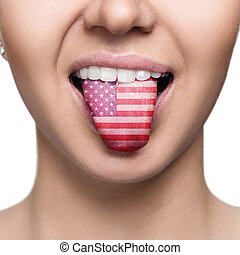 Young woman showing tongue with american flag.