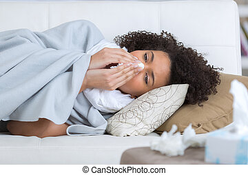 young woman sick with flu