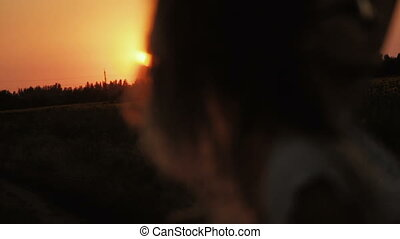 young woman silhouette at sunset. Series.