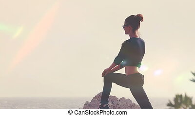 Young Woman Silhouette Yoga On The Beach At Sunset
