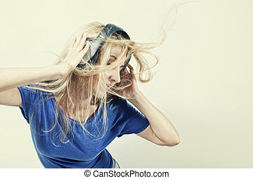 young woman singing with headphones