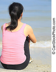 young woman sit on beach