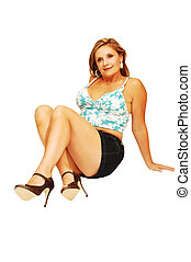 Young woman sitting 22. - An friendly blond woman in a blue...