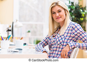 Young woman sitting at her desk