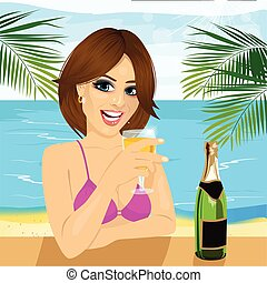 woman sitting at table at the beach drinking glass of champagne