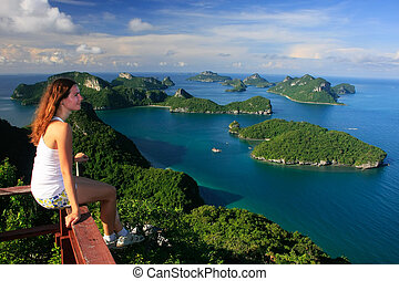 Young woman sitting at the view point, Wua Talab island, Ang...