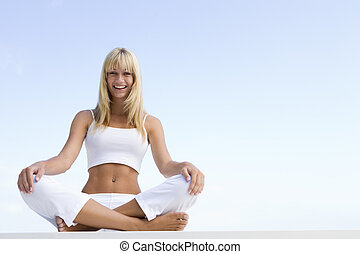 Young woman sitting cross legged