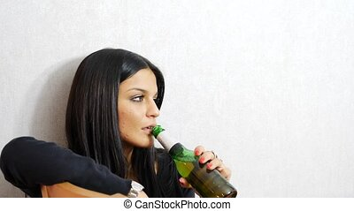 Young woman sitting drinking alone at a table - Young man...