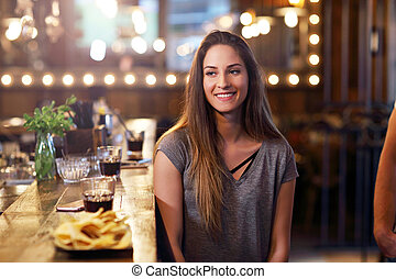 Young woman sitting in a cafe