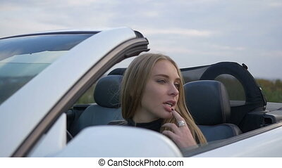 Young woman sitting in a car