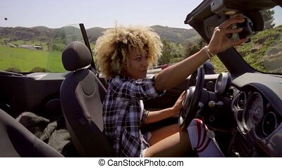 Young Woman Sitting In Cabriolet. - Young woman adjusted the...