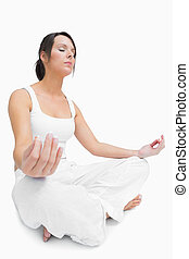 Young woman sitting in lotus position