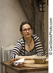woman sitting in the pizzeria