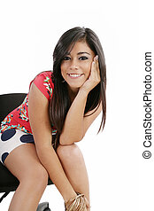 young woman sitting on a chair isolated over white background