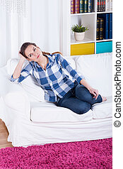 Young woman sitting on a couch