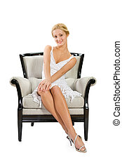young woman sitting on chair against isolated white background