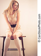 Young woman sitting on chair