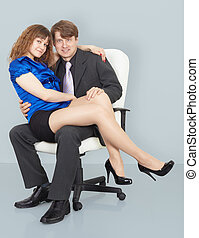 Young woman sitting on lap of a man