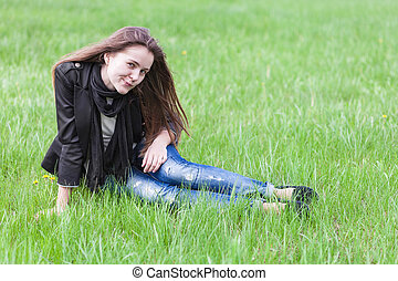 Young woman sitting on lawn