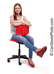 Young Woman sitting on red chair