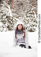 Young woman sitting on snow