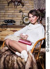 Young woman sitting on the chair