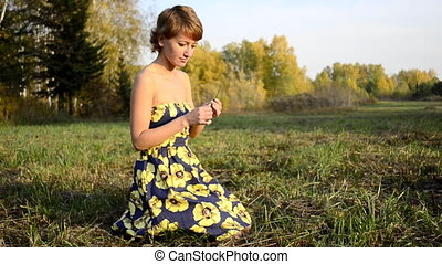 Young woman sitting on the grass in