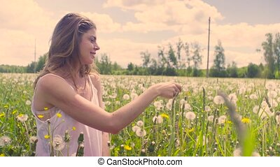Young woman sitting on the meadow