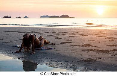 woman sitting on the sea beach
