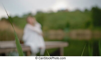 Young woman sitting on the wooden pier