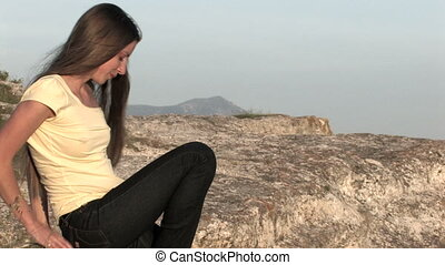 young woman sitting on top of the