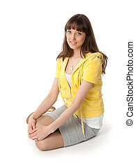 Young woman sitting on white
