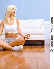 Young Woman Sitting on Wood Floor Meditating