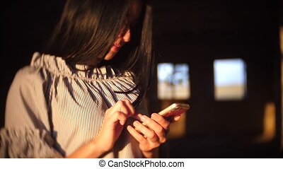 Young woman sitting using smartphone in coffee cafe, urban...