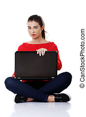 Young woman sitting with a laptop