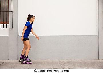 Young woman skating outdoors