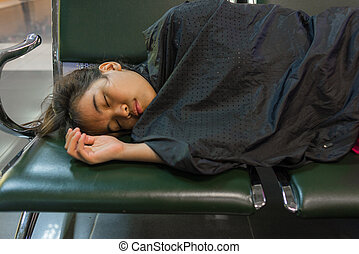 Young woman sleeping in the airport