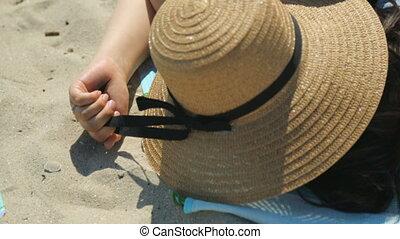 Young woman sleeping on beach