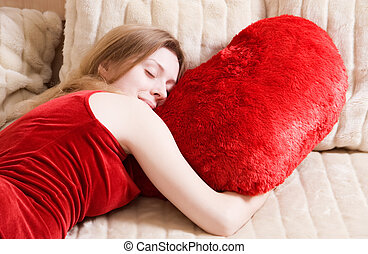 Young woman sleeping on red pillow