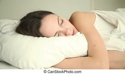Young woman sleeping soundly - Young beautiful serene female...