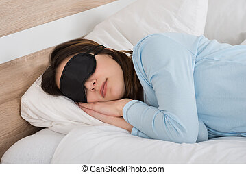 Woman Sleeping With Eyemask On Bed