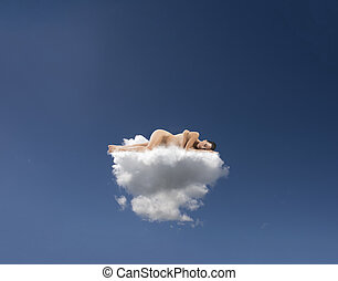 Young woman sleeps on a mattress made of clouds