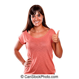 Young woman smiling and showing you ok sign
