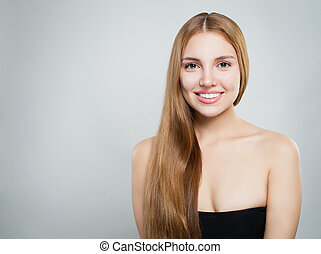 Young woman smiling. Beautiful girl with healthy hair and clear skin on white background