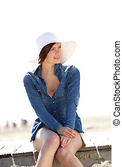 Young woman smiling by beach
